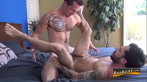 Inked hunk rides raw cock